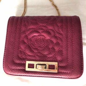 Burgundy over the shoulder handbag